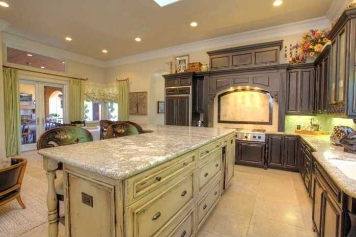This kitchen is near perfection with expansive Epicurean amenities with conversation area, granite counters, travertine floors and more.
