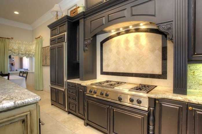 The kitchen also includes double dishwashers, ovens, warming drawer and six-burner range.
