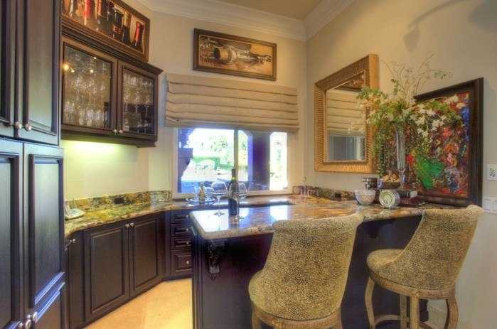 Love wine? This home has a wine cellar and gentleman's bar.