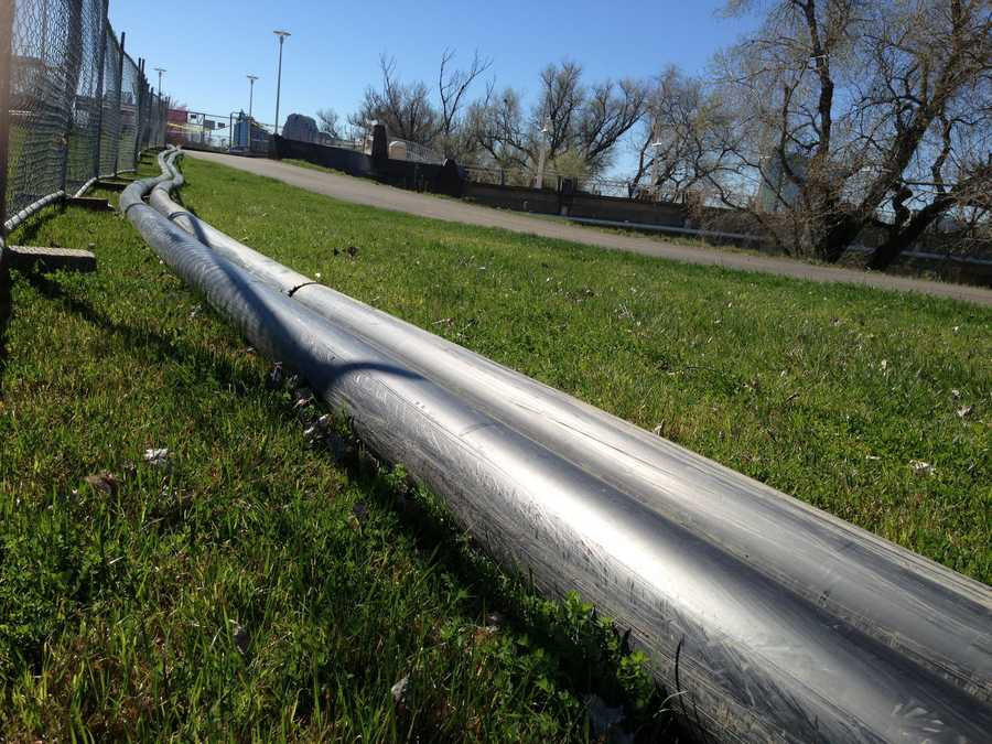 One pipe carries sediment-laden water away from the plant and another returns clear water.