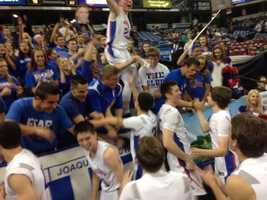 Folsom players celebrate the 68-51 NorCal CIF D1 basketball championships victory that took them to state.