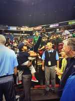 Modesto Christian's coach accepted his state championship trophy with his son.