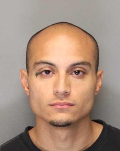 Julio Demetrio Gayton, 26, was arrested on suspicion of fatally stabbing a victim in Woodland, police said.