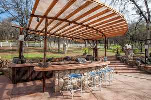 The outdoor area has a 1/3 acre swimming pond, outdoor kitchen mezzanine and a large picnic area.