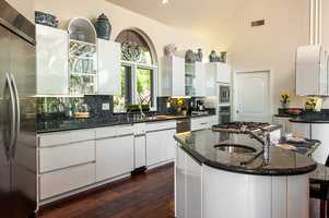 The kitchen has plenty of counter space and modern cabinetry.