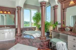 Enjoy the views from almost anywhere inside the home, including this spacious bathroom.