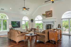 This grand room shines with all the natural light and high ceilings.