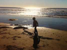 20.) I am a certified massage therapist. I took interest in massage after my dad grew ill. It relaxes me. Pictures like this relax me, too. This is my son, Thomas, on the beach.