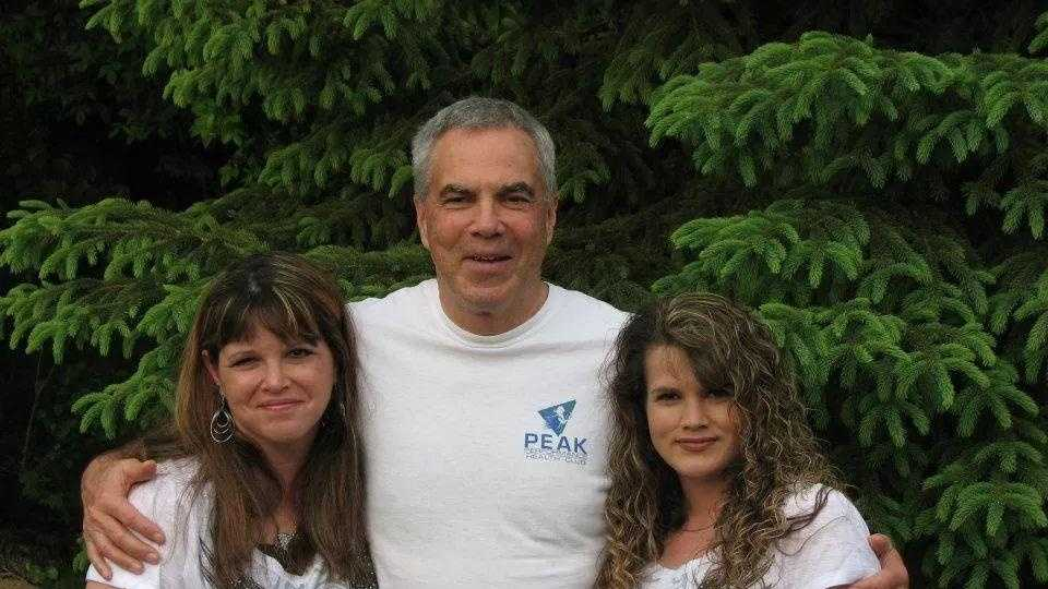 Sacramento climber Jim Geiger poses for a photo with his two daughters, Shelly Dippel, left, of Illinois, and Deanna Geiger, of Sacramento, at right.