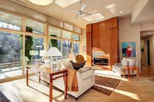 This living space gets plenty of light with the floor-to-ceiling window panes.