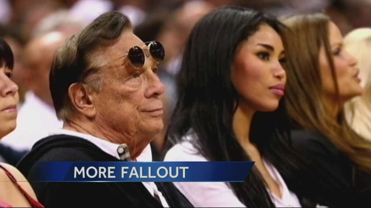 Donald Sterling is still legally married. He is seen here with his girlfriend V. Stiviano.