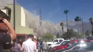 A teacher in Rancho Cucamonga sent in this video of smoke from a massive fire approaching her school. The school has since been evacuated.