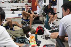 Members of the men's Capital Crew squad relax between races.
