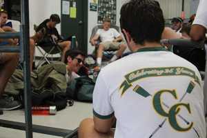Members of Capital Crew's men's squads relax between races.