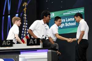 Team captain Daniel Shen shakes the hand of a competitor.