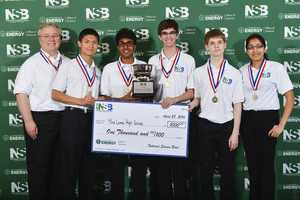 After winning their second national championship in two years, Mira Loma's Science Bowl team posed with their check. From left to right, coach James Hill, team captain Daniel Shen, Arvind Sundararajan, Matt Kempster, Jack Gurev, and Preethi Raju