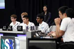 The team listens to the question during competition at the US Department of Energy headquarters.