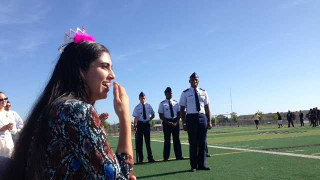 Sufia Mehmood, 17, reacts to a surprise ceremony at River City High School on Thursday morning.