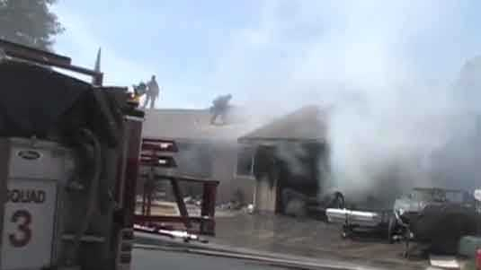 A garage fire broke out at a home on Harvest Road in Modesto on Friday. (May 23, 2014)