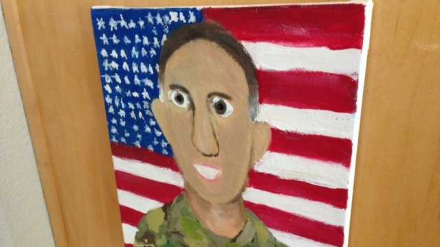A portrait of a Placer County dad deployed in Afghanistan hangs near the Aaron family's kitchen.