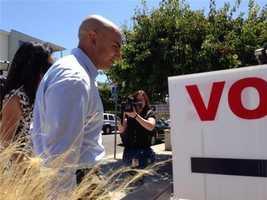 Kashkari arrives to vote in Laguna Beach.