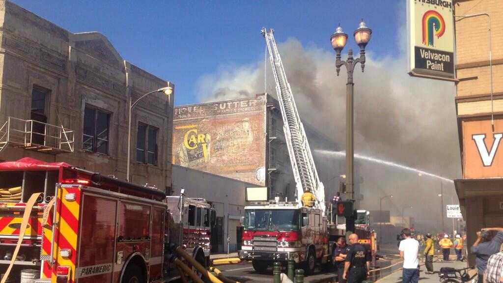 Firefighters battle a fire that broke out at a historic downtown building in Stockton. (June 4, 2014)
