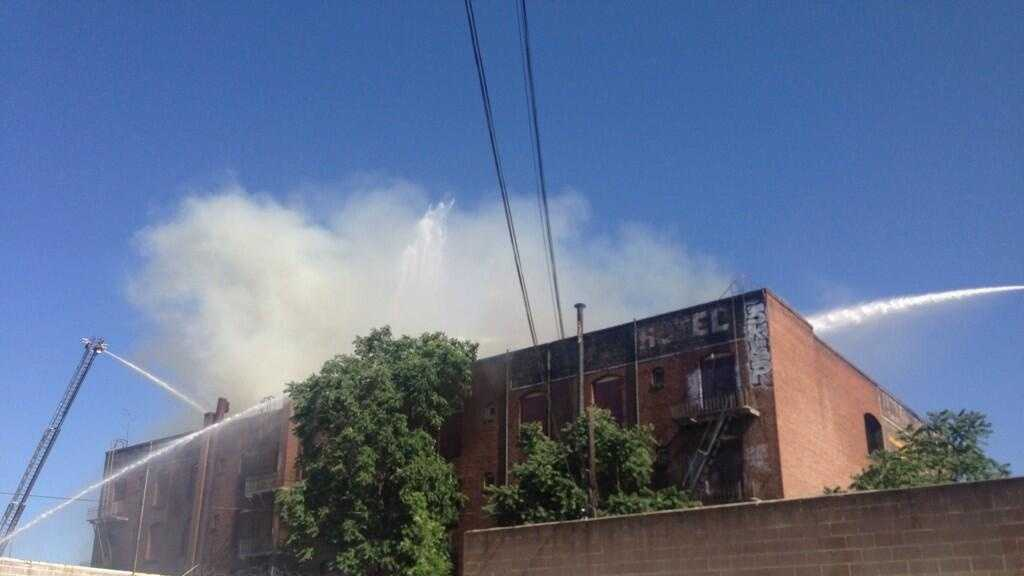 Firefighters work to contain a fire that broke out at a building in downtown Stockton on Wednesday. (June 4, 2014)