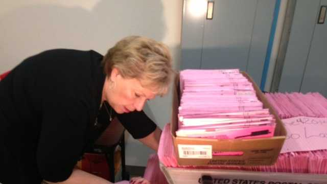 Sacramento Voter Registrar Jill LaVine examines ballots received after the 8 p.m. Tuesday deadline.