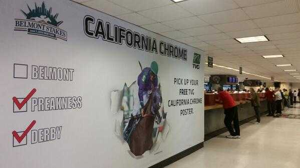 A larger-than-life picture of California Chrome and his jockey Victor Espinoza were seen near a betting area at Belmont Park. (June 5, 2014)