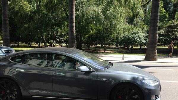 Texas Gov. Rick Perry drives into Sacramento in a Tesla, trying to capture California jobs (June 10, 2014).