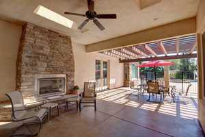 After going for a dip, you can enjoy this outdoor living space with a fireplace.