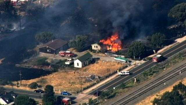 A grass fire burned several homes Friday afternoon along Interstate 680 in Solano County. (June 20, 2014)