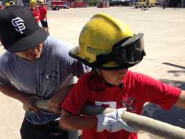 Campers get to experience the power of a fire hose.