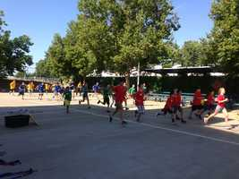 The camp starts each day with physical fitness training.