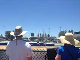 Crowds, including the parents of athletes, watch the men's junior pole vaulting competition.