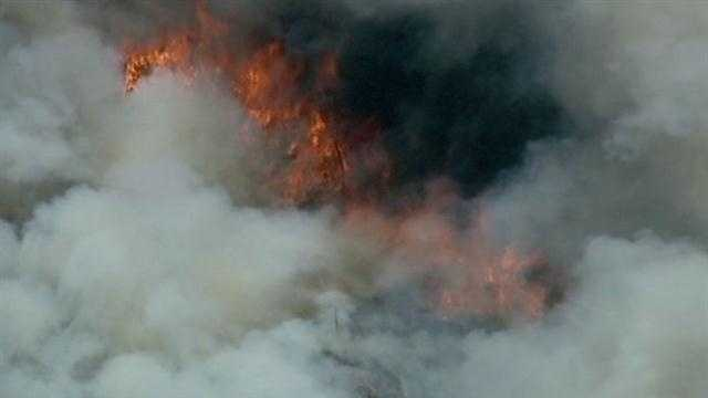 A large wildfire has charred thousands of acres in a rural area of Napa County.