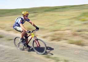 """Bonus slide! Bike riding is one of my favorite ways to stay fit. I pedaled my road bike across Nevada from Stateline, Lake Tahoe to the Utah border along Highway 50. It's the section of road dubbed """"America's Loneliest Road"""" by Time magazine -- perfect for a cyclist."""