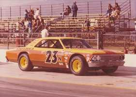 24.) I get my need for speed from my dad. He drove race cars at T-Car in Carson City and occasionally made appearances in Roseville, West Sacramento and Stockton. This photo was taken at Ontario Motor Speedway. That's me on the bleachers.