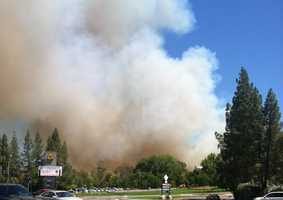 A four-alarm grass fire is kicking up a large amount of smoke in and around Cal Expo on Friday afternoon. (July 4, 2014)