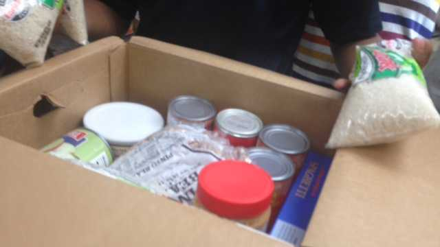 Food boxes distributed to San Joaquin County families. (July 7, 2014)