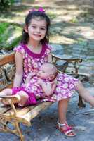 """Carlie and her big sister take a photo on Easter Sunday. Edie wrote on Facebook: """"We got all dressed up for Easter but then between feeding the baby and accommodating nap times we never left the house and missed the celebrations. At least my hubby got a few photos!"""""""