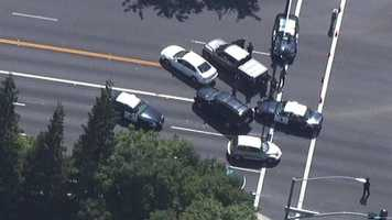 A witness told KCRA 3's Melinda Meza that two men came out of the bank with AK-47-type guns held to the heads of three women. The women were crying and looked terrified, the witness said.