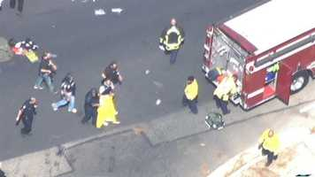 LiveCopter 3 video showed a man in handcuffs being taken into police custody near a bullet-riddled sport-utility vehicle at Thorton Road and Otto Drive.