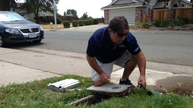 Roseville water specialist John Shannon inspects a leak.