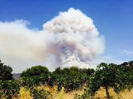 A plume of smoke from the Sand Fire burning in Amador and El Dorado counties. (July 27, 2014)