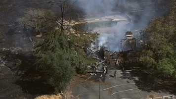 Fire crews extinguished a grass fire in Lincoln on Friday afternoon that also involved a structure. (Aug. 1, 2014)
