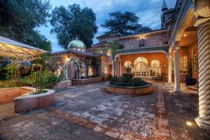 The backyard is secluded, features an open courtyard and leads to the home's guest quarters.
