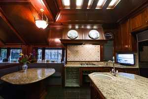 The kitchen features open concept, plenty of counter space and light.