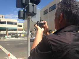People stopped to take pictures of the Downtown Plaza demolition. (Aug. 13, 2014)