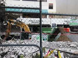 The first phase of demolition is under way at the Downtown Plaza, the site of the new downtown sports and entertainment complex. (Aug. 13, 2014)